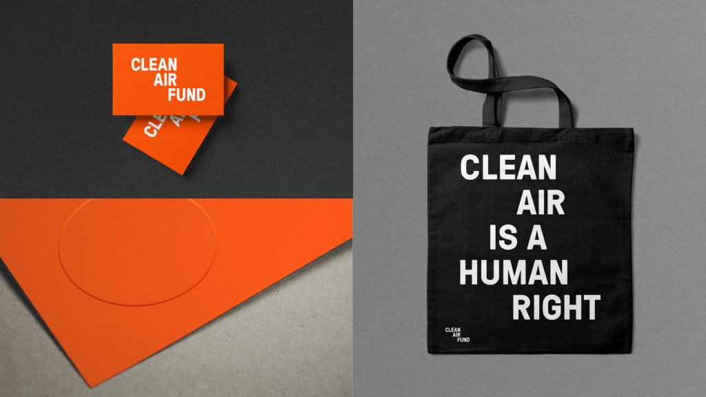 A range of materials printed with the Clean Air Fund logo (clockwise from top left): business cards, a tote bag and the corner of a pamphlet.