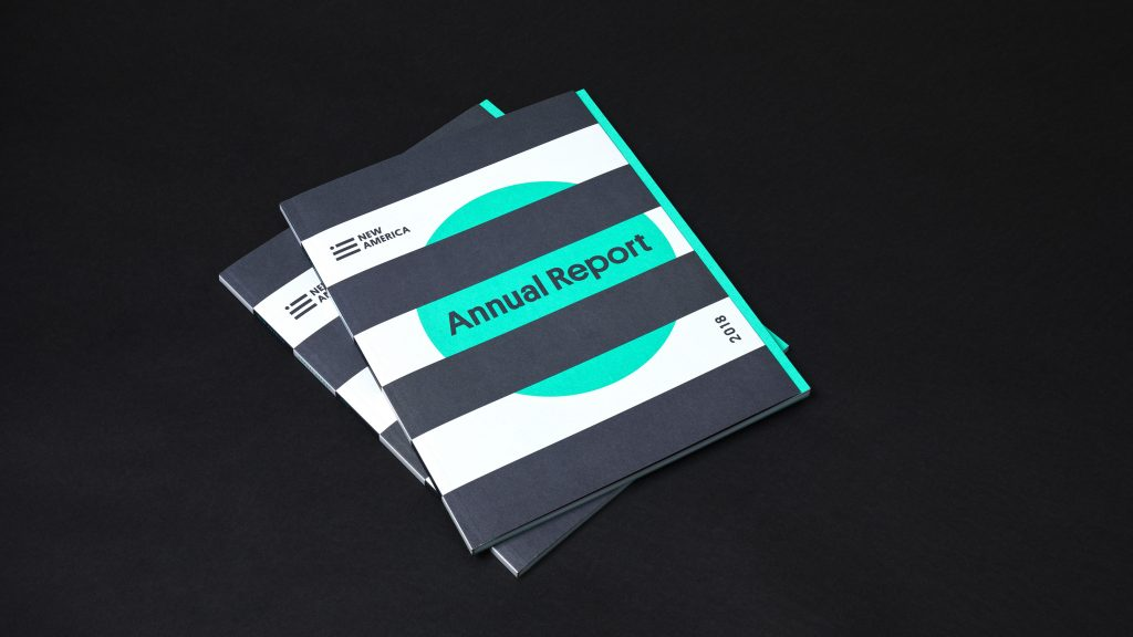 A stack of 2018 New America annual reports showing the front cover.