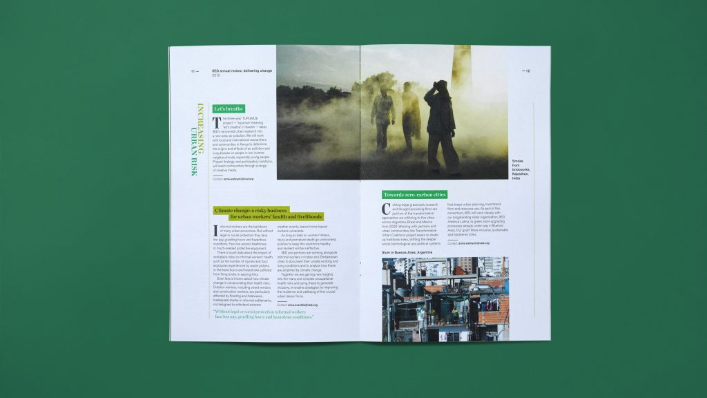An inside page spread showing photographs and columns of text.
