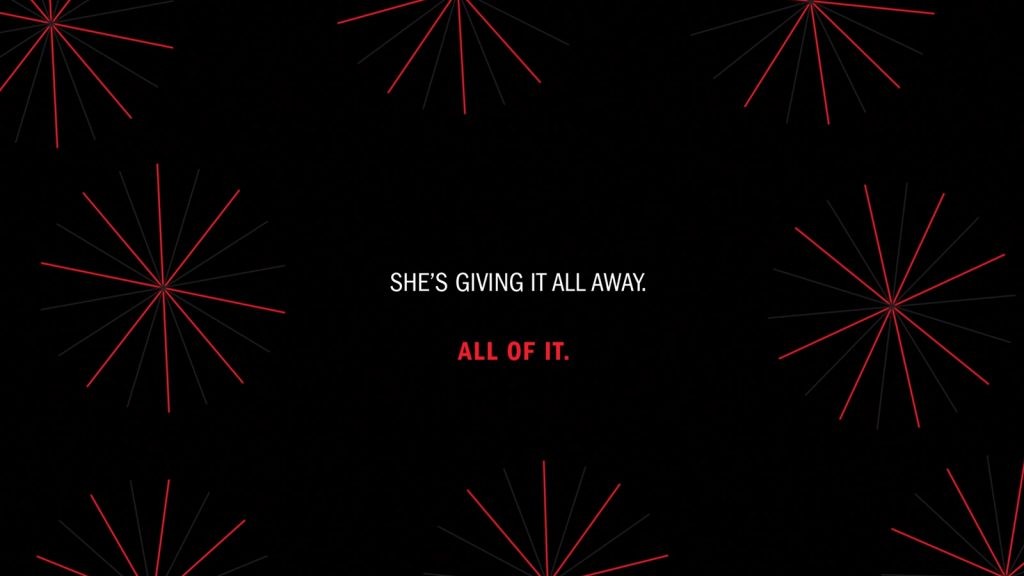 "The text ""She's giving it all away. All of it."" in white and red type surrounded by fine red lines organised in star shapes on a black background"