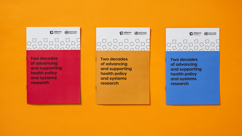 Three publication covers in (from left) red, yellow and blue.