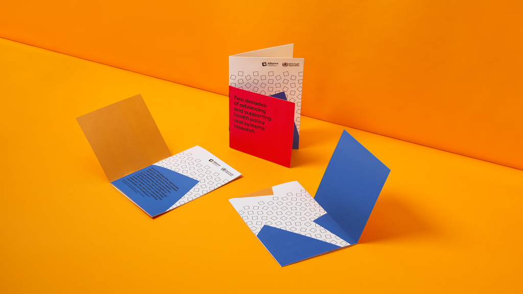 A mock-up of three publications showing a range of designs and fold-out covers.